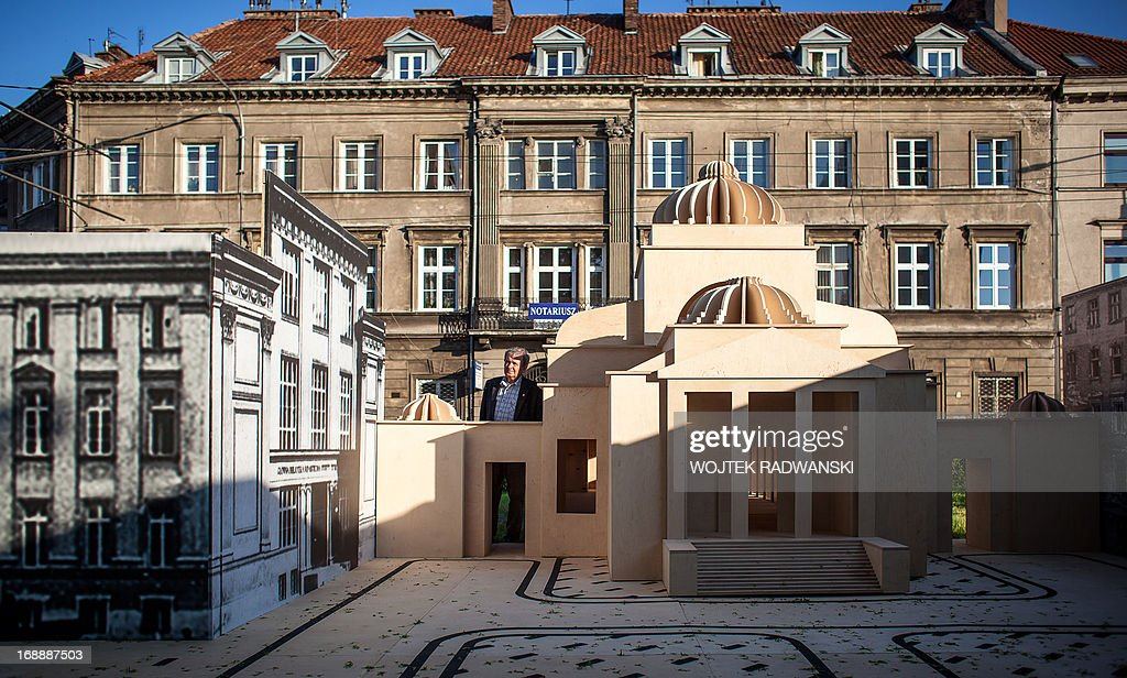 A man looks at the 1-10 scale model of the largest synagogue in pre-war Warsaw, the Great Synagogue seen on May 16, 2013 in Warsaw. The model is installed on the place near the original location 70 years after it was destroyed during World War II Warsaw Ghetto liquidation.