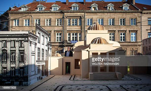 A man looks at the 110 scale model of the largest synagogue in prewar Warsaw the Great Synagogue seen on May 16 2013 in Warsaw The model is installed...