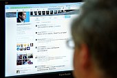 A man looks at the computer screen with a page of Russian Prime Minister Dmitry Medvedev in Twitter in Moscow on August 14 2014 Hackers broke into...