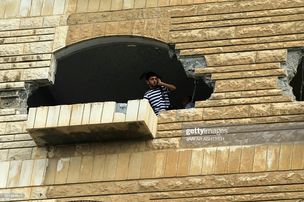 A man looks at the damage in the West Bank city of Nablus on May 3, 2016, after Israeli forces destroyed the house of Zaid Amer, a Palestinian man accused of taking part in the killing of a Jewish settler couple near the settlement of Itamar in October last year. The Jewish couple was shot in front of their young children as they drove on a West Bank road between the northern settlements of Itamar and Elon Moreh. ASHTIYEH