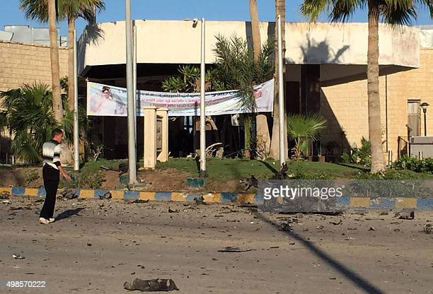 A man looks at the damage outside the Swiss Inn hotel in the Egyptian town of ElArish in the Sinai peninsula following an attack on the hotel by two...