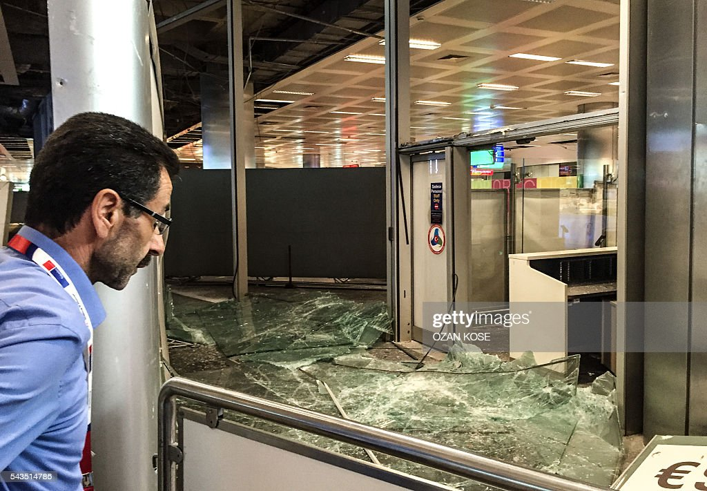 A man looks at the damaged explosions site in Ataturk airport's international arrivals terminal on June 29, 2016, a day after a suicide bombing and gun attack targeted Istanbul's airport, killing at least 36 people. A triple suicide bombing and gun attack that occurred on June 28, 2016 at Istanbul's Ataturk airport has killed at least 36 people, including foreigners, with Turkey's prime minister saying early signs pointed to an assault by the Islamic State group. / AFP / OZAN