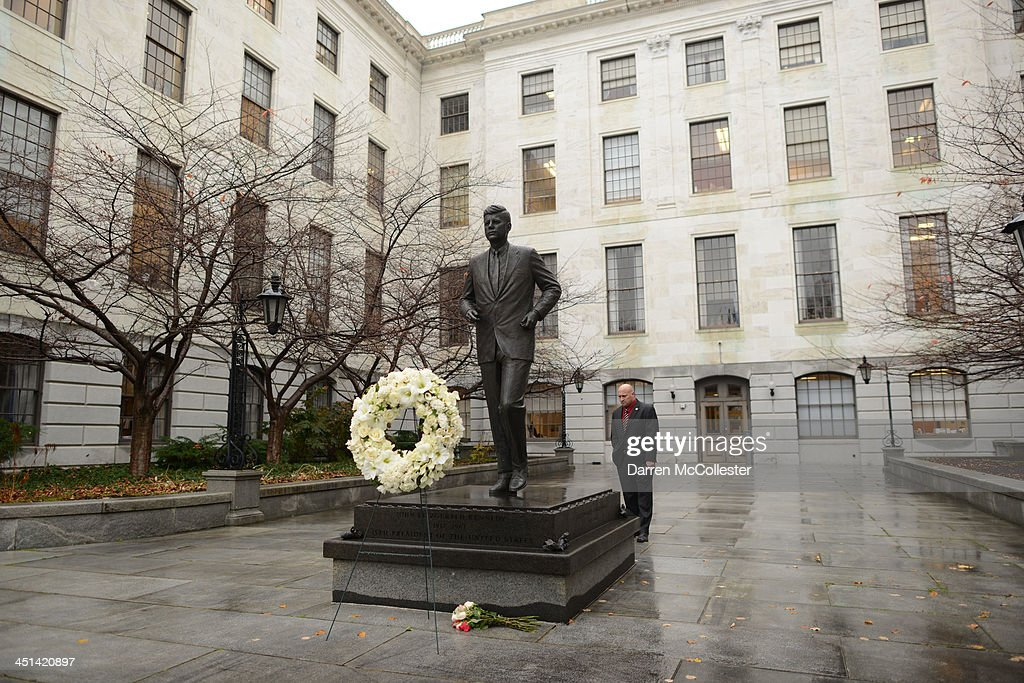A man looks at the John F. Kennedy statue at the State House November 22, 2013 in Boston, Massachusetts. Kennedy, born in Brookline Massachusetts, was killed 50 years ago on this day by Lee Harvey Oswald in Dallas Texas in 1963.