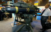 A man looks at the latest USmade Hellfire II missiles during at the defense industry exhibition in Taipei 11 August 2005 Some 21 weapon companies...