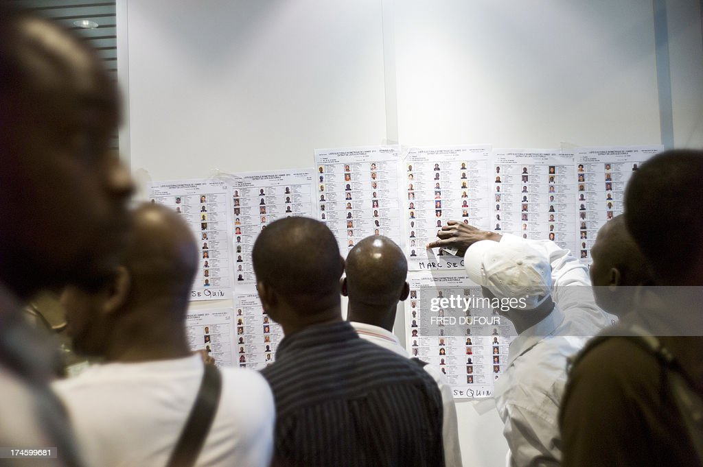 A man looks at the list of biometric voters at the Malian consulat in Bagnolet, near Paris on July 28, 2013 during the Malian presidential elections. Malians voted today for a president expected to usher in a new dawn of peace and stability in the conflict-scarred nation. They have a choice of 27 candidates as they vote for the first time since last year's military coup upended one of the region's most stable democracies, as Islamist militants hijacked a separatist uprising to seize much of the country .