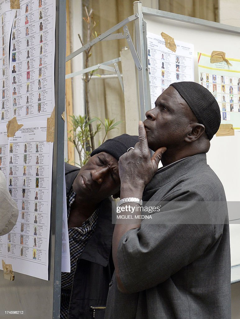 A man looks at the list of biometric voters at the Malian embassy in Paris on July 28, 2013 during the Malian presidential elections. Malians voted today for a president expected to usher in a new dawn of peace and stability in the conflict-scarred nation. They have a choice of 27 candidates as they vote for the first time since last year's military coup upended one of the region's most stable democracies, as Islamist militants hijacked a separatist uprising to seize much of the country. AFP PHOTO / MIGUEL MEDINA