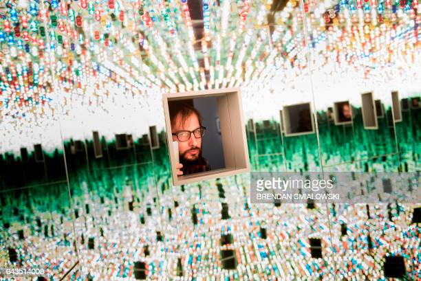 A man looks at the Love Forever room during a preview of the Yayoi Kusama's Infinity Mirrors exhibit at the Hirshhorn Museum February 21 2017 in...