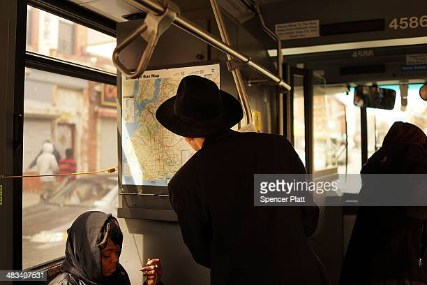 A man looks at the map for the B46 bus on April 8 2014 in the Brooklyn borough of New York City The B46 bus which runs through parts of Crown Heights...