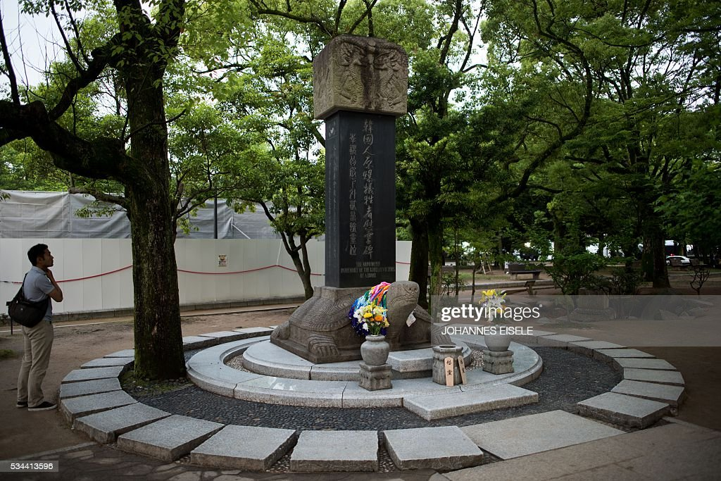 A man looks at the 'Monument in remembering of the Korean victims of A-bomb' in the Hiroshima Peace Memorial park in Hiroshima on May 26, 2016. US President Barack Obama is set to become the first sitting US president to visit one of the bomb sites when he journeys on May 27, 2016 with Japanese Prime Minister Shinzo Abe to Hiroshima, hallowed ground to Japanese but, for more than 70 years, a no-go zone for 11 of his Oval Office predecessors. / AFP / JOHANNES