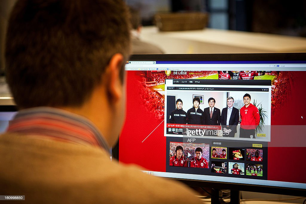 A man looks at the new Japanese website of Belgian football team Standard de Liege on February 8, 2013 in Brussels. Standard de Liege have a number of Japanese players on their team.