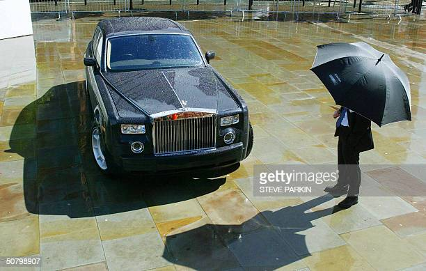 A man looks at the new ultraexclusive Rolls Royce Centenary Phantom made for the 100th anniversary of the founding of the company in Manchester...