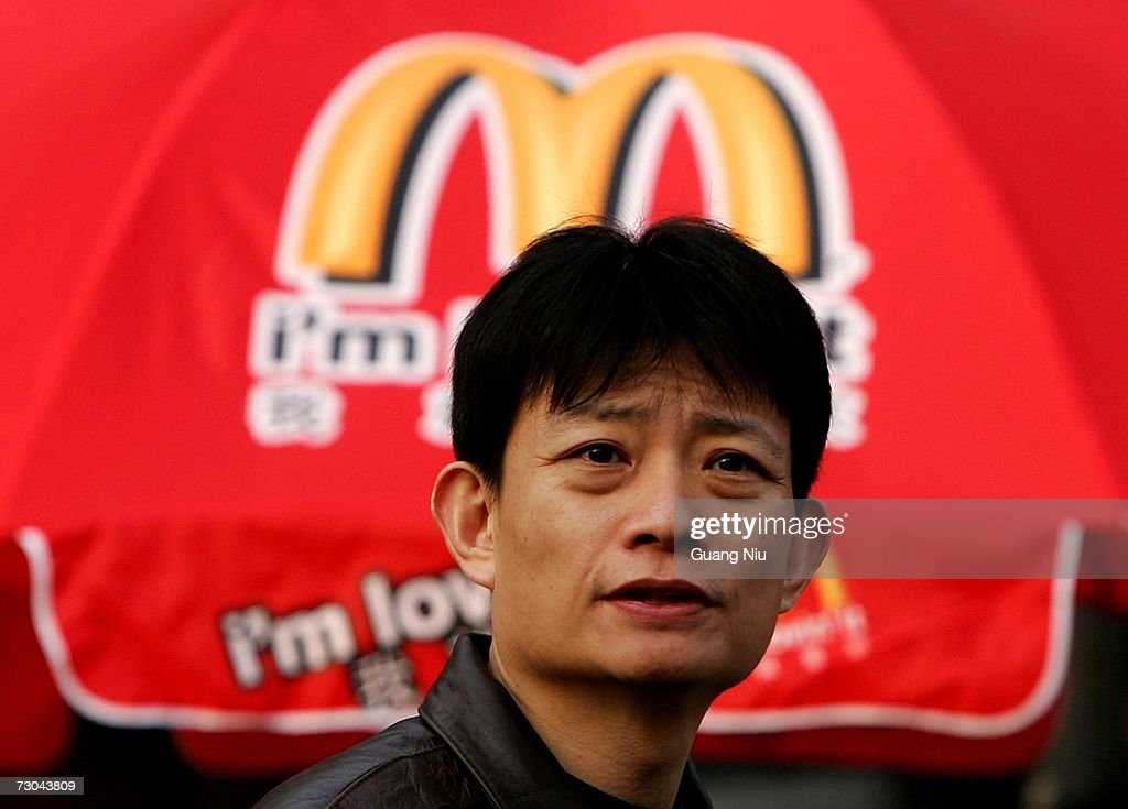 A man looks at the opening ceremony for a new McDonald's drive-thru facility on January 19, 2007 in Beijing, China. McDonald's opened its first restaurant in mainland China in 1990, in Shenzhen, Guangdong province and now operates 760 restaurants countrywide, which employ over 50,000 people.