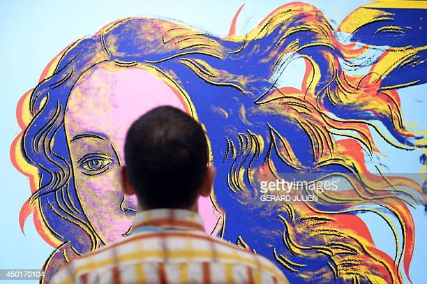 A man looks at the painting 'Details of Renaissance Paintings Botticelli Birth of Venus' by US artist Andy Warhol during an exhibition titled 'Pop...