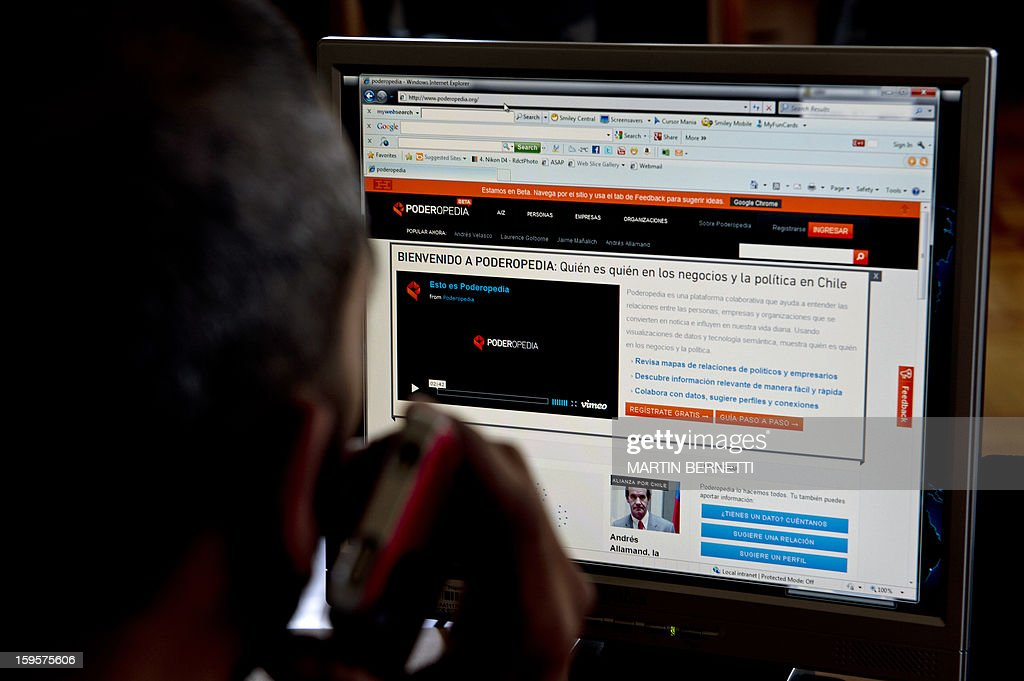 A man looks at the Poderopedia website in Santiago, on January 16, 2013. Poderopia, awarded by US Knight News Challenge foundation, is a website launched at the end of 2012 which gathers information about economic investments of politics, contact and influence networks of businessmen among others, to bring to light the clash of interests in power and contribute with greater transparency.
