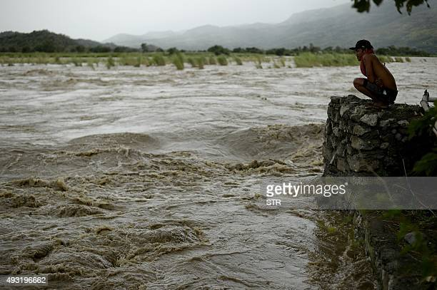 A man looks at the rising water level of the Magat River caused by continuous rains of Typhoon Koppu at Bayombong Nueva Viscaya on October 18 2015...