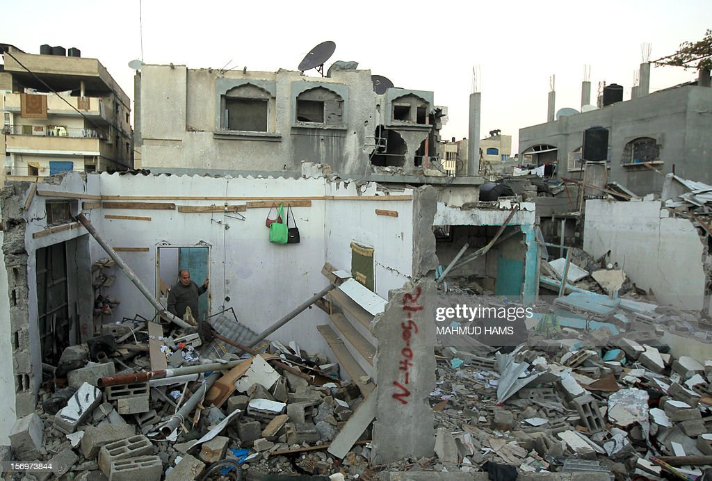 A man looks at the rubble of a destroyed building in Beit Lahia, in the northern Gaza Strip, on November 26, 2012, following a truce last week between Israel and Hamas that ended eight days of conflict in which 166 Palestinians and six Israelis were killed.