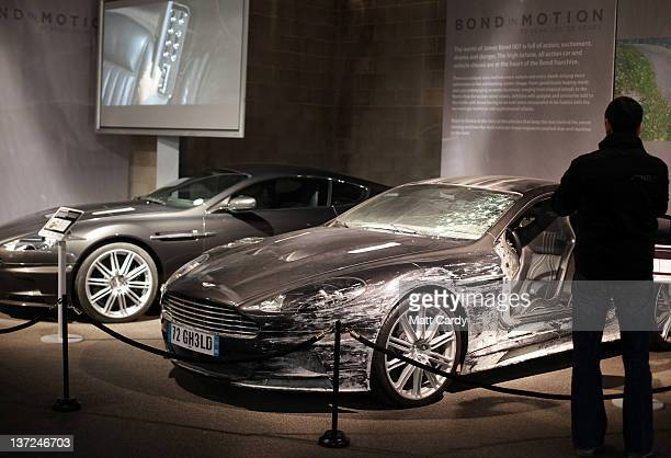 A man looks at the two Aston Martin DBS that were used in the James Bond film Quantum Of Solace and currently being displayed at the Bond In Motion...