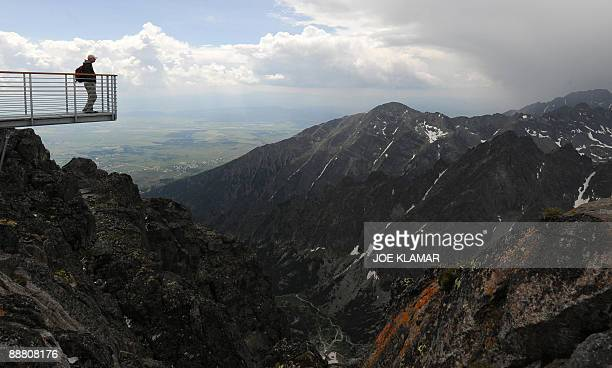 A man looks at the view from the peak of the Lomnicky Stit the home of an observatory in the High Tatras mountains on July 2 2009 The coronal station...