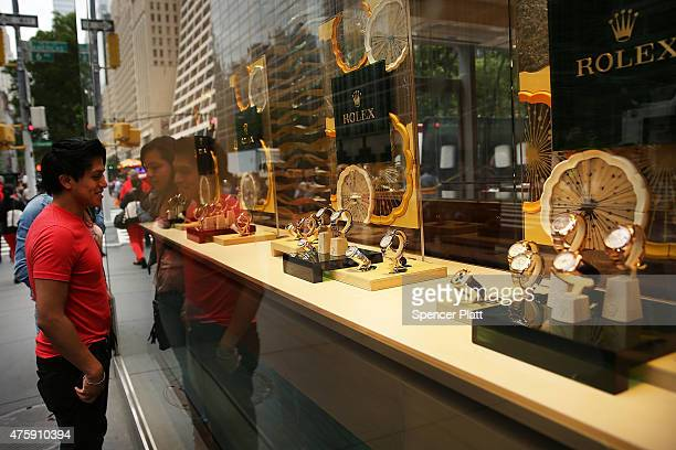 A man looks at watches in a window display along a Manhattan street on June 4 2015 in New York City As the Apple Watch and other smartwatches...