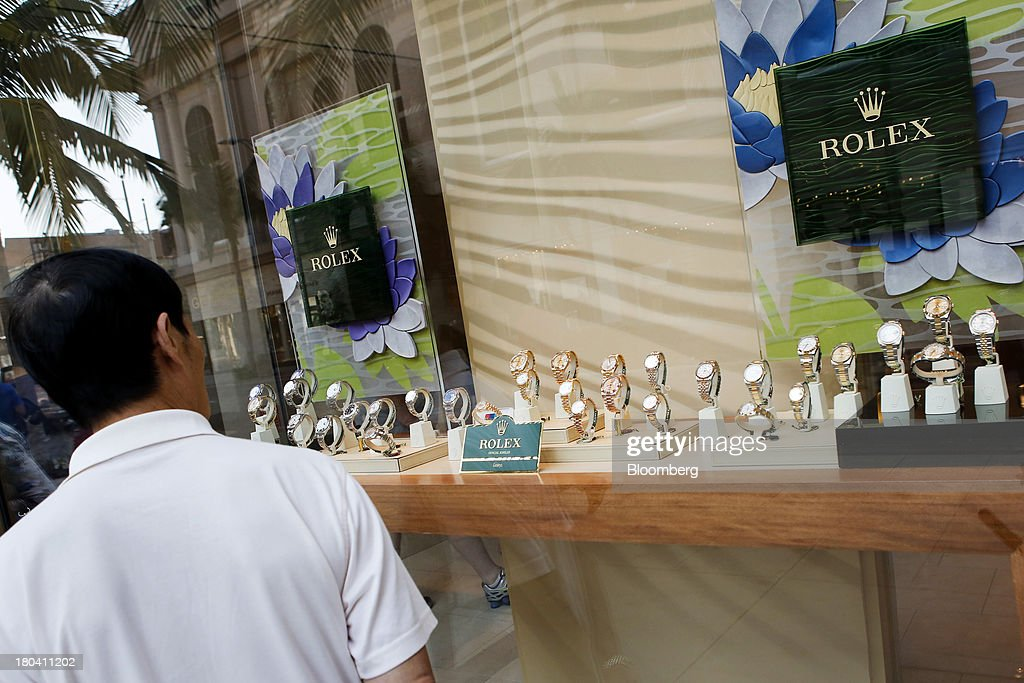 A man looks at watches in the window of a Rolex Group store on Rodeo Drive in Beverly Hills, California, U.S., on Wednesday, Sept. 11, 2013. The U.S. Census Bureau is scheduled to release retail sales figures on Sept. 13. Photographer: Patrick T. Fallon/Bloomberg via Getty Images