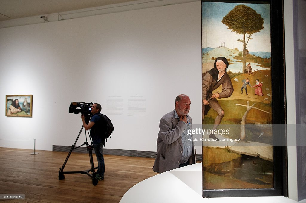 A man looks at works of Dutch painter Hieronymus Bosch during a press preview at El Prado Museum on May 27, 2016 in Madrid, Spain. The Prado Museum holds the 'El Bosco' (Hieronymus Bosch) painter major exhibition to celebrate the fifth century anniversary of the Dutch artist's death (ca. 1450-1516) featuring sixty five works from various Spanish and global museums.