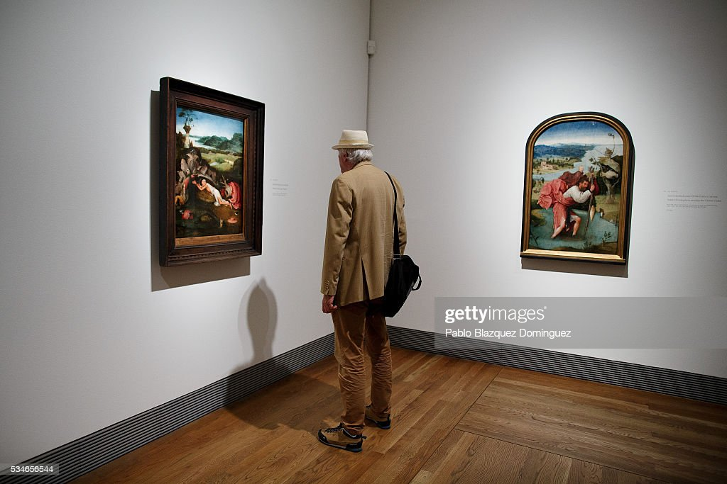 A man looks at works of Dutch painter Hieronymus Bosch during a press preview at El Prado Museum on May 27, 2016 in Madrid, Spain.The Prado Museum holds the 'El Bosco' (Hieronymus Bosch) painter major exhibition to celebrate the fifth century anniversary of the Dutch artist's death (ca. 1450-1516) featuring sixty five works from various Spanish and global museums.