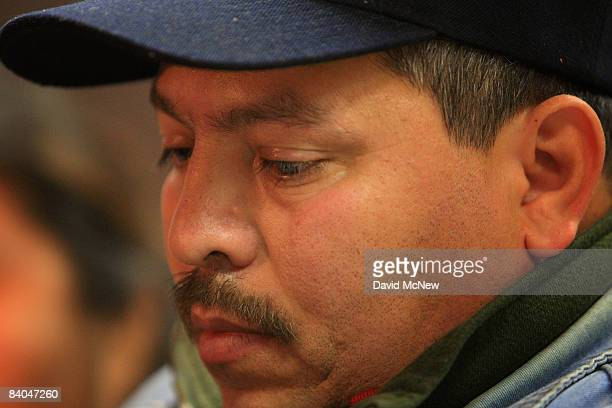 A man looks down as he with other immigrants is taught his legal rights at a forum during Know Your Rights Week on December 15 2008 in Los Angeles...