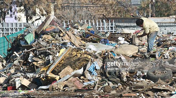 A man looks for objects to recycle and sell at a rubbish dump in Santiago on June 12 2013 Chile stands on top of Latin American countries in waste...