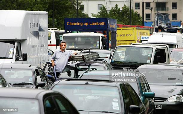 A man looks from his car during a traffic gridlock near Vauxhall Cross in London 22 July 2005 The area was plunged into chaos after emergency...