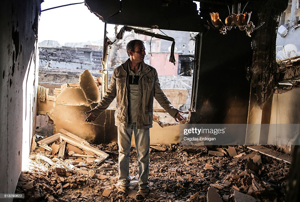 A man looks in despair at his ruined house in Cizre March 2 Turkey Turkish authorities scaled down a 24hour curfew imposed on the mainly Kurdish town...