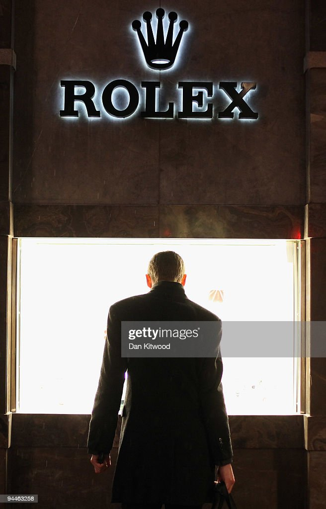 A man looks in the Rolex Store on Oxford Street on December 14, 2009 in London, England. High street stores are expecting a bumper Christmas this year despite the economic dowturn, with shoppers spending around GBP £120 million in the past two days alone.