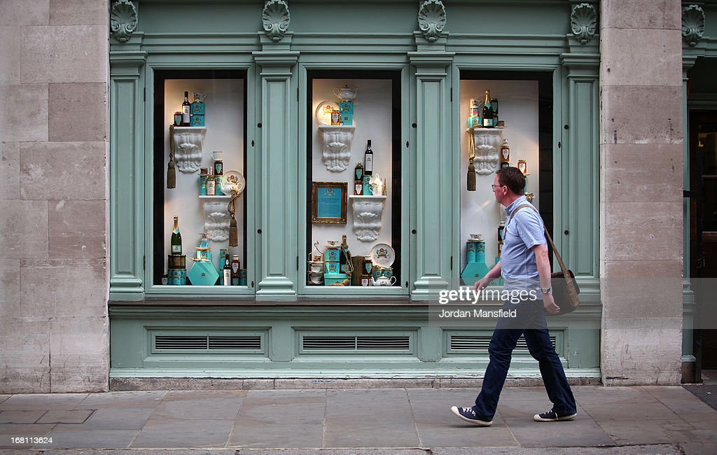 A man looks into the one of the window displays at the rear of Fortnum and Mason on May 5, 2013 in London, England. Fortnum and Mason have kept bees on their rooftop terrace for the last 7 years. At this time of year, the London Honey Company return the bees to their renovated hives.