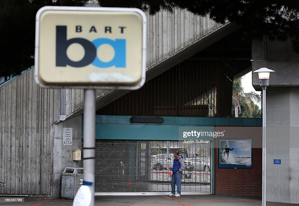 A man looks into the shuttered Bay Area Rapid Transit (BART) West Oakland station on October 21, 2013 in Oakland, California. BART workers continue to strike after contract negotiations between BART management and the transit agency's two largest unions fell apart last week. Management and unions agreed on the financial specifics of the contract but differed on workplace safety rules. An estimated 400,000 commuters ride BART each day.