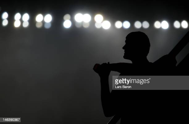 A man looks on after play was suspended due to bad weather during the UEFA EURO 2012 group D match between Ukraine and France at Donbass Arena on...