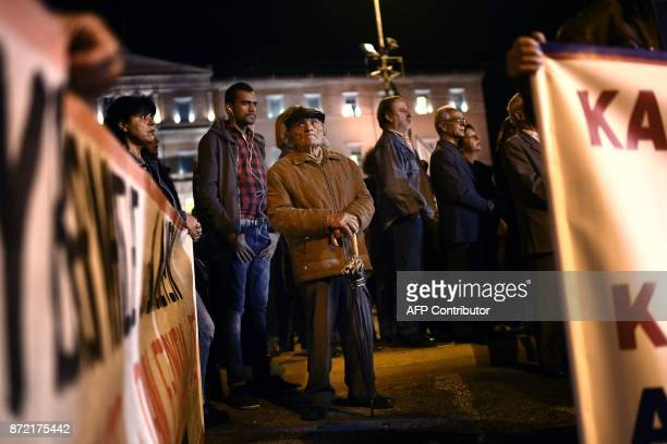 A man looks on as he takes part in a march called by Greek Communist labour union to protest against the new upcoming austerity measures during a...