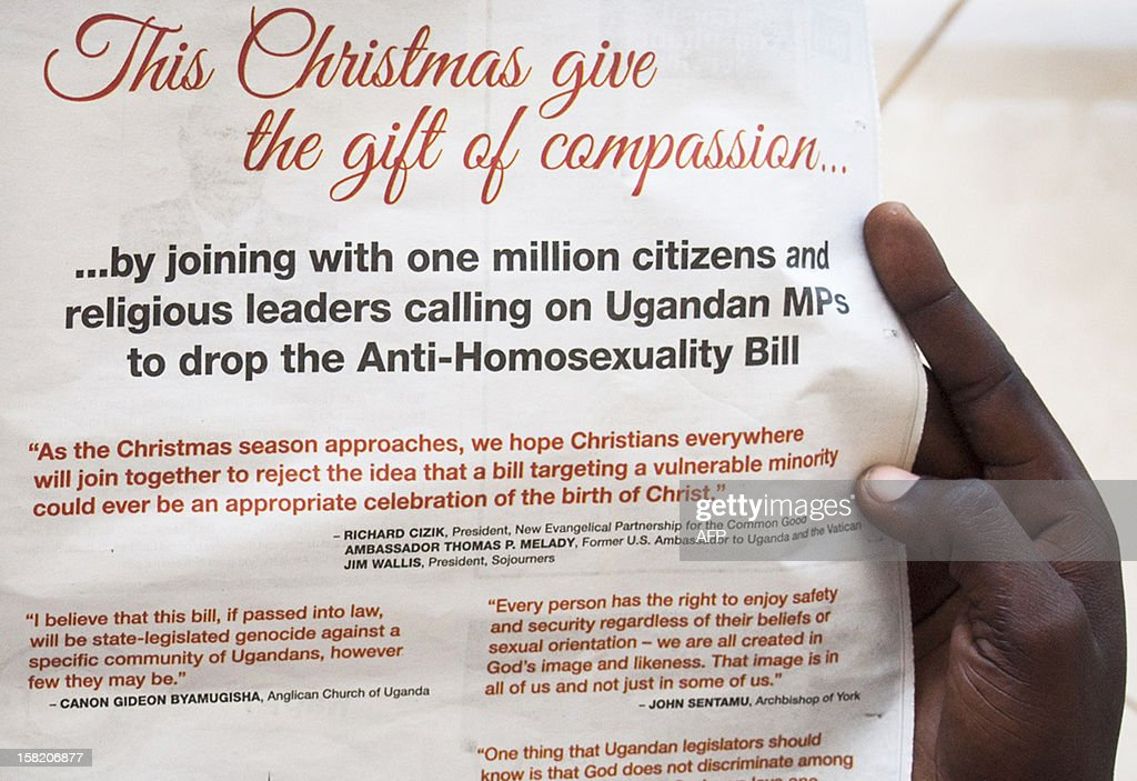 A man looks on December 11, 2012 at an advertising by campaign group Avaaz in the state-owned Ugandan newspaper The New Vision, protesting against an anti-homosexuality bill. Homosexuality is already illegal in Uganda, but the new bill proposes to introduce the death sentence for anyone caught engaging in homosexual acts for a second time, as well as for gay sex where one partner is a minor or has HIV. It would also criminalize the public promotion of homosexuality -- including discussions by rights groups -- with a sentence of up to seven years in prison for anyone convicted.