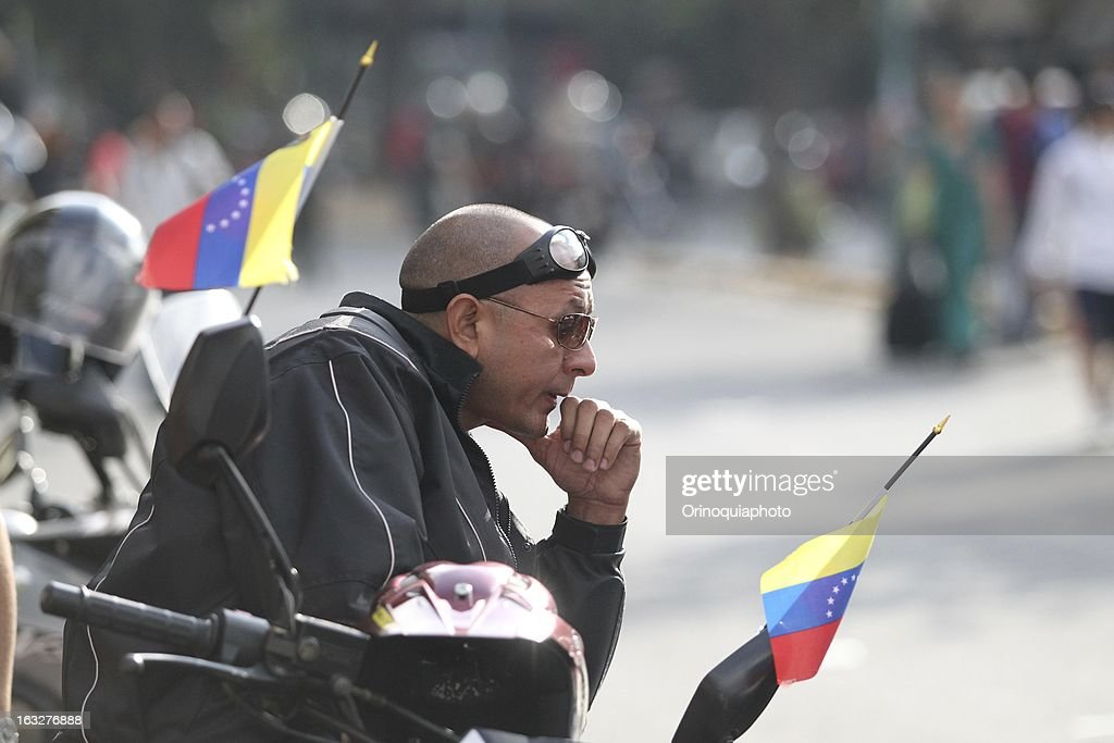 A man looks on during the march of the supporters of President Hugo Chavez through the streets of Caracas to the military academy on March 06, 2013 in Caracas, Venezuela.
