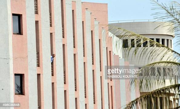 A man looks on from a window at the Radisson Blu hotel in Bamako on November 20 2015 Gunmen went on a shooting rampage at the luxury hotel in Mali's...