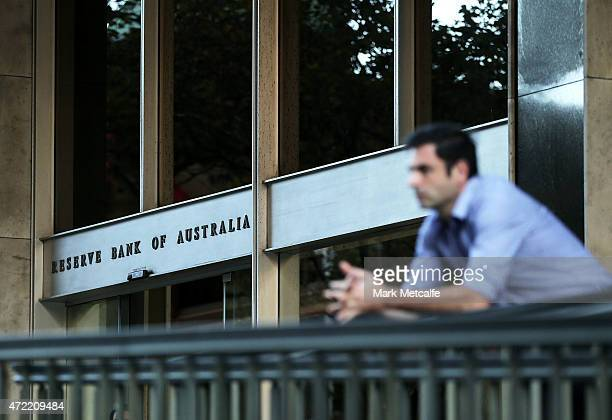 A man looks on outside the Reserve Bank of Australia headquarters on May 5 2015 in Sydney Australia Forecasters are predicting the Reserve Bank of...