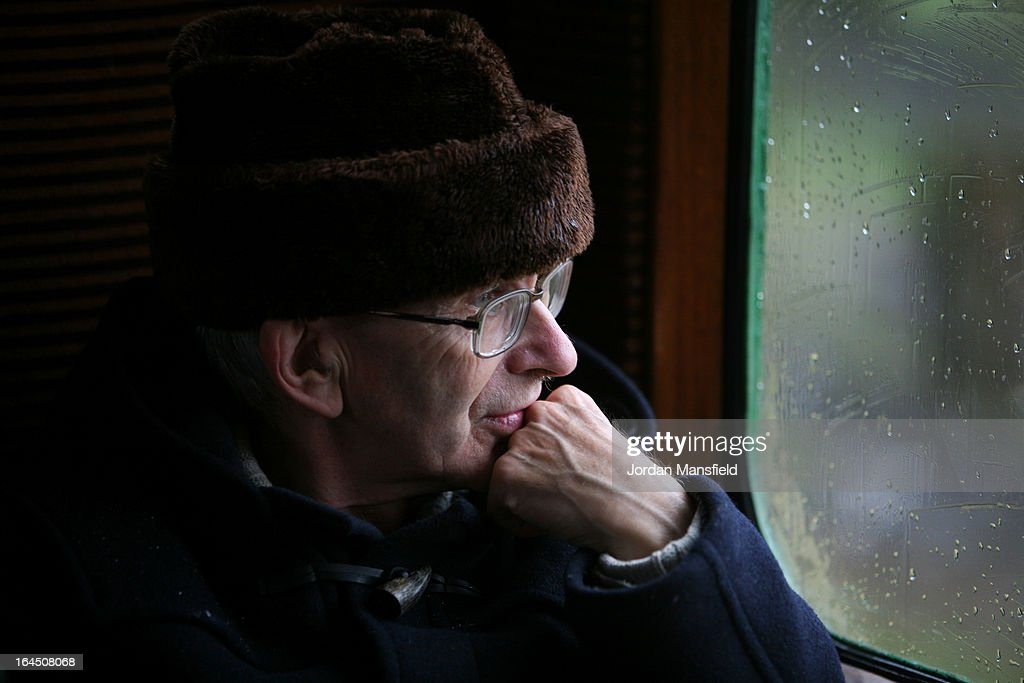 A man looks out a window as he rides a train from Sheffield Park to East Grinstead on March 23, 2013 in Horsted Keynes, EnglandThe Bluebell Railway ran its first steam train this weekend on the reclaimed line from Kingscote to East Grinstead after volunteers from the Bluebell Society worked to reopen the line after its closure on March 17, 1958. 50 years on from Dr. Richard Beeching's report signaling the widespread closure of rural rail routes across the UK, Britain's railways are in great demand with old lines reopening and pressure on to restore rural lines that were closed.