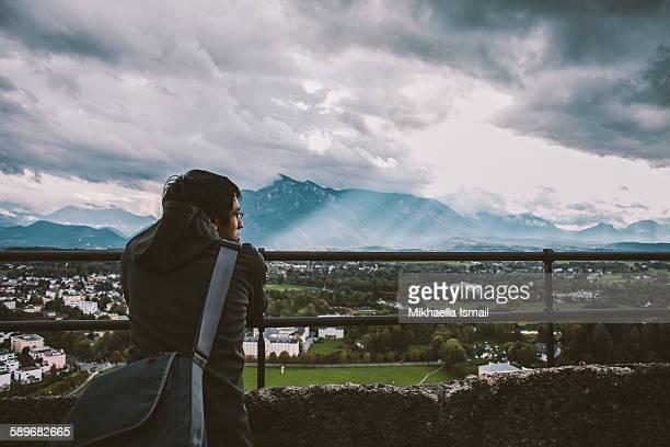 Man looks out at Salzburg landscape