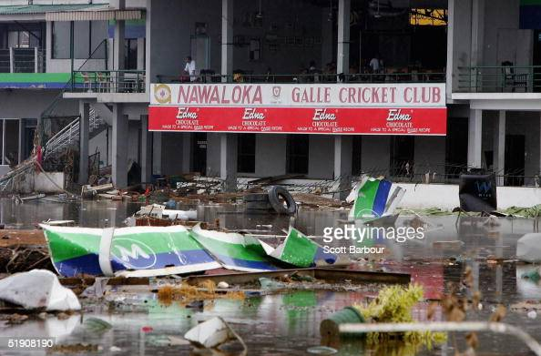 A man looks out at the damage to Galle Cricket Club caused by the tsunami on January 1 2005 in Galle Sri Lanka UN Secretary General Kofi Annan who...