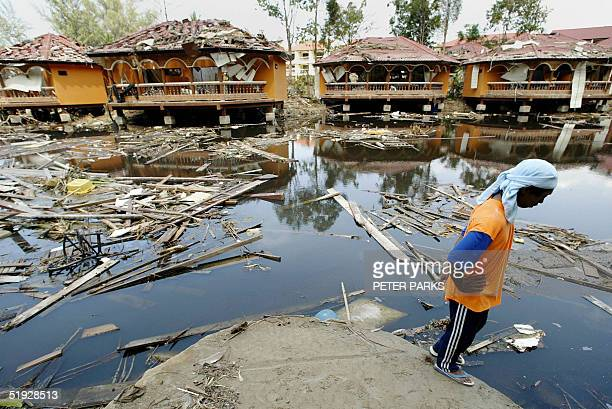 A man looks out at the remains of a hotel resort in Khao Lak in Thailand's Phang Nga province 09 January 2005 which took the full force of the...