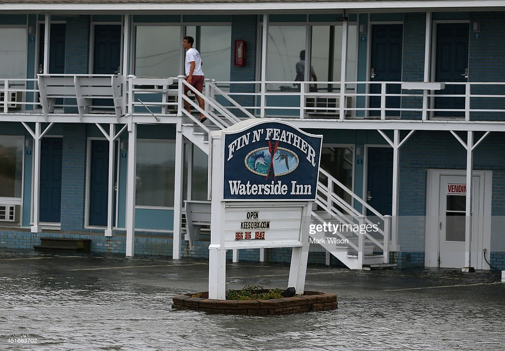 A man looks out from a hotel that was flooded by Hurricane Arthur, July 4, 2014 in Nags Head, North Carolina. Hurricane Arthur hit North Carolina's outer banks overnight causing wide spead power outages, flooding and damage.