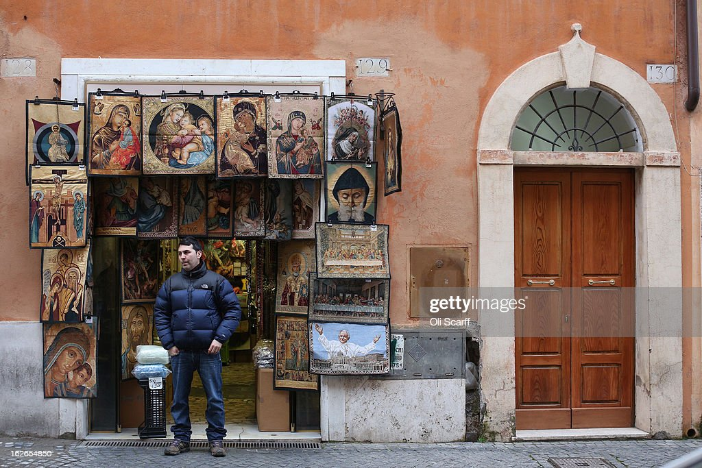 A man looks out from his shop selling religious souvenir merchandise on February 25, 2013 in Rome, Italy. The Pontiff will hold his last weekly public audience on February 27, 2013 before he retires the following day. Pope Benedict XVI has been the leader of the Catholic Church for eight years and is the first Pope to retire since 1415. He cites ailing health as his reason for retirement and will spend the rest of his life in solitude away from public engagements.