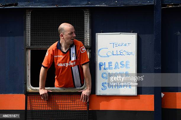 A man looks out from the ticket collection booth at Kenilworth Road prior to the Skrill Conference Premier match between Luton Town and Forest Green...