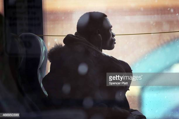 A man looks out of a bus window during a snow storm on February 5 2014 in Burlington Vermont Burlington and much of the Northeast received another...