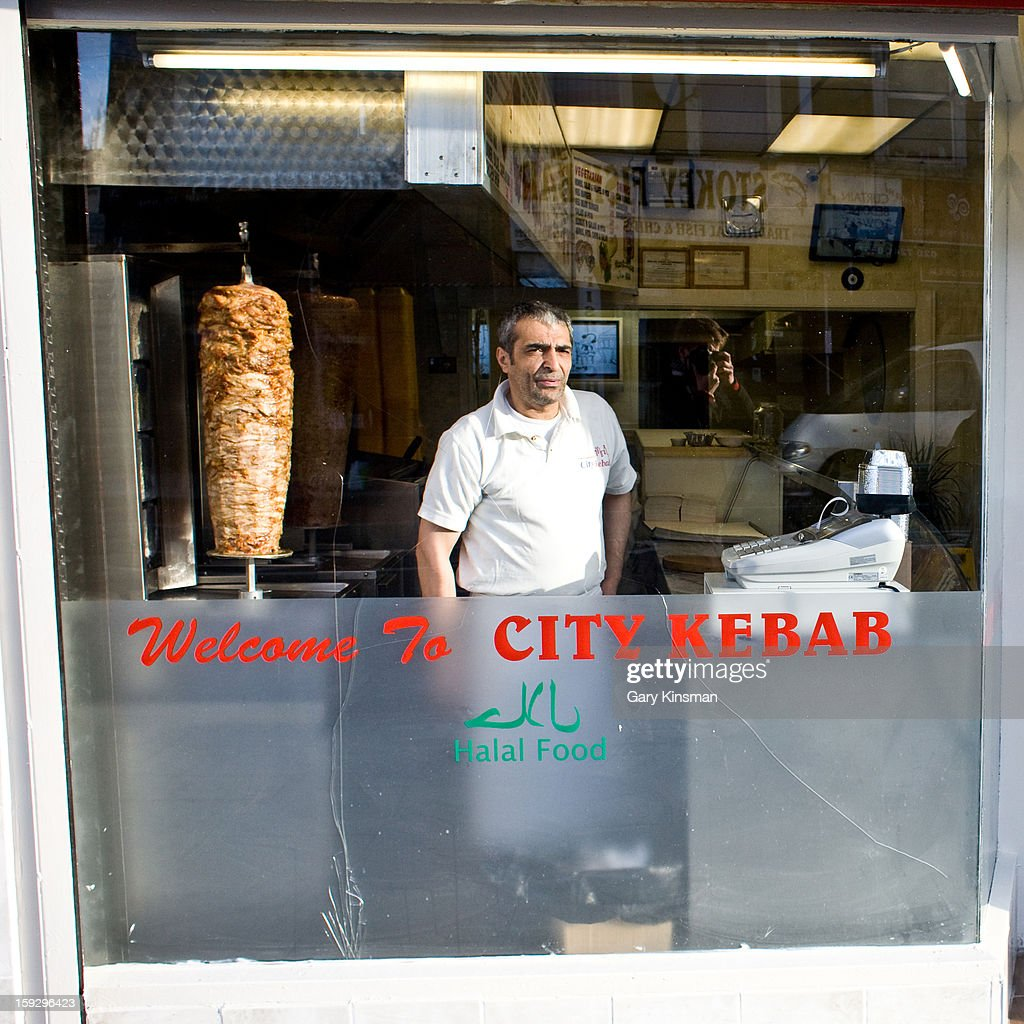 CONTENT] A man looks out of the window of the City Kebab restaurant in Stoke Newington, London