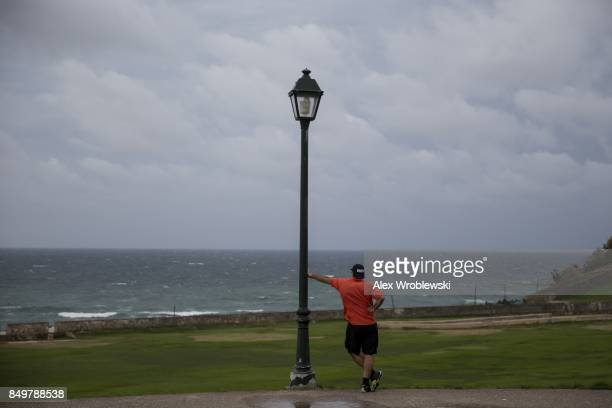 A man looks out over the Caribbean Sea as Hurricane Maria approaches on September 19 2017 in San Juan Puerto Rico Puerto Rico Gov Ricardo Rossello is...