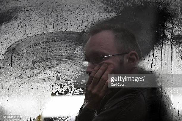 A man looks out through a window on a bus at Victoria Station on January 9 2017 in London England Millions of people are facing severe travel...
